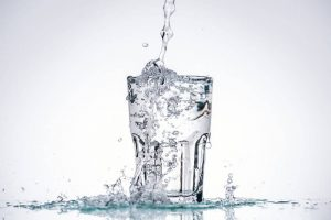 water overflowing glass