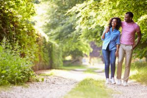 happy couple walking in countryside | LCR Health