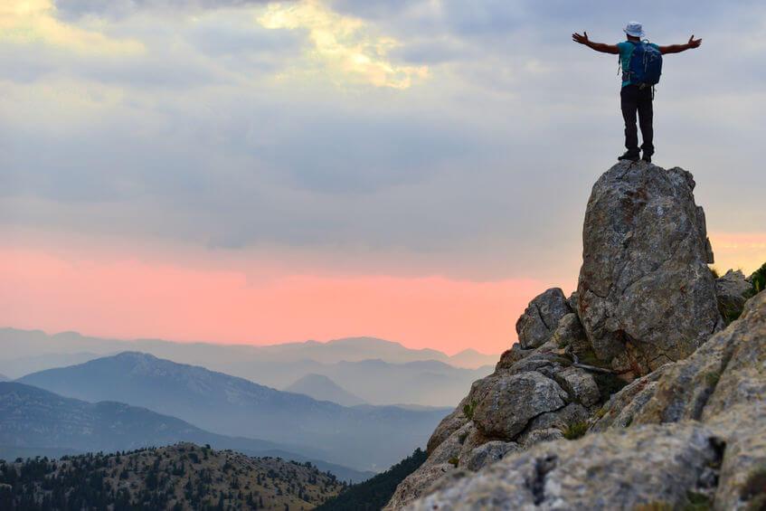 man on pinnacle | LCR Health