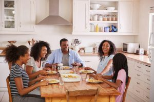 family enjoying meal together | LCR Health