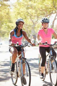 women riding bikes | LCR Health
